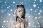 Beautiful woman with disco ball and snow — Stock Photo