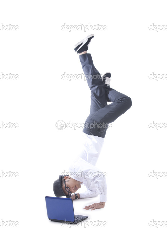 Asian businessman with hat doing a handstand while using his laptop — Stock Photo #7835035