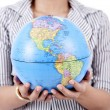 Close up of businesswoman holding a globe — Stockfoto