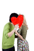Young mix race couple kissing — Stock Photo