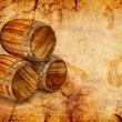 Royalty-Free Stock Photo: Old barrels on a grunge background