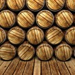 Wall of wooden barrels - Stock Photo