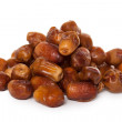 A pile of dates isolated on a white background — Stock Photo #7447477