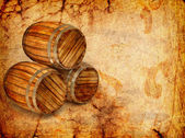 Old barrels on a grunge background — Stock Photo