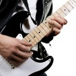 Guitarist playing on electric guitar - Stock Photo