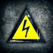 Symbol of high voltage on a steel background - Stock Photo
