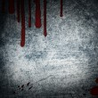 Steel background with drop of blood - Stock Photo