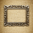 Golden frame on a canvas background — Foto Stock