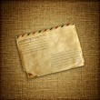 Vintage envelop on brown canvas — Stock Photo