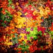 Grunge background with colourful puzzles — Stock Photo #7456307