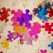 Grunge background with colourful puzzles — Stock Photo #7456443