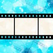 Film strip on glowing blue background — Stock Photo #7456769