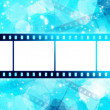 Film strip on glowing blue background — Stock Photo #7456803