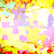 Grunge background with colourful puzzles — Stock Photo