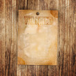 Royalty-Free Stock Photo: Vintage wanted poster on a wooden wall