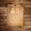Stock Photo: Vintage wanted poster on a wooden wall