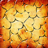 Orange hearts on a grunge background — Stock Photo