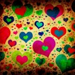 Grunge background with colorful hearts — Stock Photo