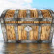 Treasure chest standing in water — Stock Photo