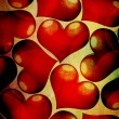 Red hearts on a grunge background — Stock Photo #7474932