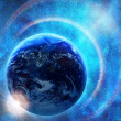 Earth in glowing blue space — Stock Photo