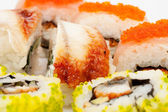 A diverse selection of delicious Japanese sushi rolls — Stock Photo