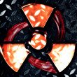 Symbol of radiation on a steel background - Stock Photo