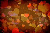 Hearts on grunge wall — Stock Photo
