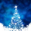 Christmas tree on the blue background — Stock Photo
