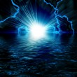 Stock Photo: Bright blue flash with lightning in the night sky