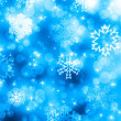 Christmas background with white snowflakes and stars — Stock Photo
