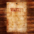 Vintage wanted poster on a wooden wall — Stock Photo