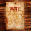 Vintage wanted poster on wooden wall — Stock Photo #7947553