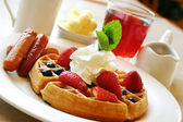 Breakfast series - Blueberry waffles with strawberries and sausages — Stock Photo