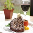 Stock Photo: Rib Eye Steak served with wine