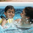 Family fun in the pool — Stock Photo
