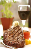 Rib Eye Steak served with wine — Stock Photo