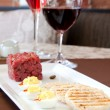 Stock Photo: Ontario Bison Tartare served with Red Wine