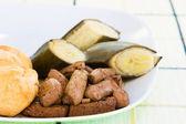 Liver, fried dumplings and banana — Stock Photo