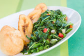 Callaloo Vegetable (Spinach) and Friend Dumplings - Caribbean St — Stock Photo