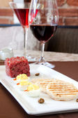 Ontario Bison Tartare served with Red Wine — Stock Photo