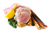 Sliced pork with spinach and parsnips — Stock Photo