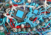 Background with turquoise, pearls and shells — Stock Photo