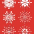 Stock Vector: Snowflakes isolated on red background