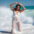 Brunette woman at the beach with white dress — Stock Photo