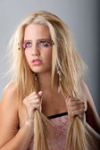 Long blond haired model in fahsion portrait — Stock Photo