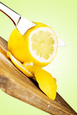 Lemon sliced with knife — Stock Photo