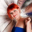 Red haired girl with umbrella — Stock Photo
