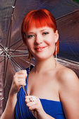 Girl smiles with umbrella — Стоковое фото