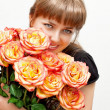 Smiles girl with roses — Stockfoto